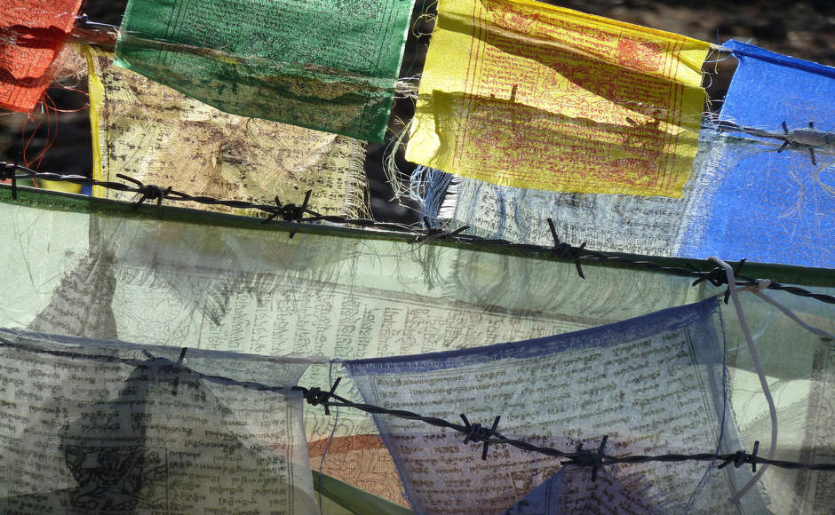 Prayer flags and barbed wire, Nepal by streets23.com